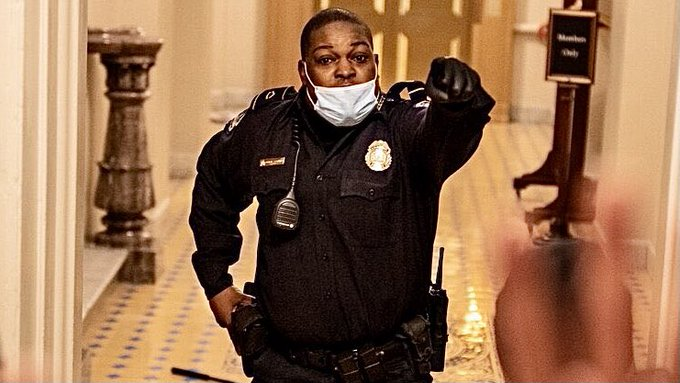 Capitol Officer Eugene Goodman confronts protestors inside the capitol, where he would ultimately lure them away from the Senate floor.